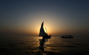 A dhow is seen at sunset during a training session on May 22, 2015 in the waters off the island of Sir Bu Nair on the eve of the Al-Gaffal 60 foot Traditional Dhow Sailing Race, in which boats will set sail off the island near the Iranian coast, until they reach the finish line at the Burj Al-Arab in Dubai. The 25th annual dhow sailing race has a total prize money of 10 million dirhams ($272,000). AFP PHOTO / MARWAN NAAMANI